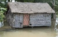 You Thach's house completely surrounded by floodwaters. Photo: Soleak Seang/Oxfam America