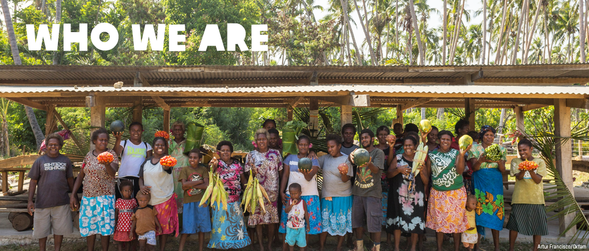 """Who we are"", picture of community members with fruit"
