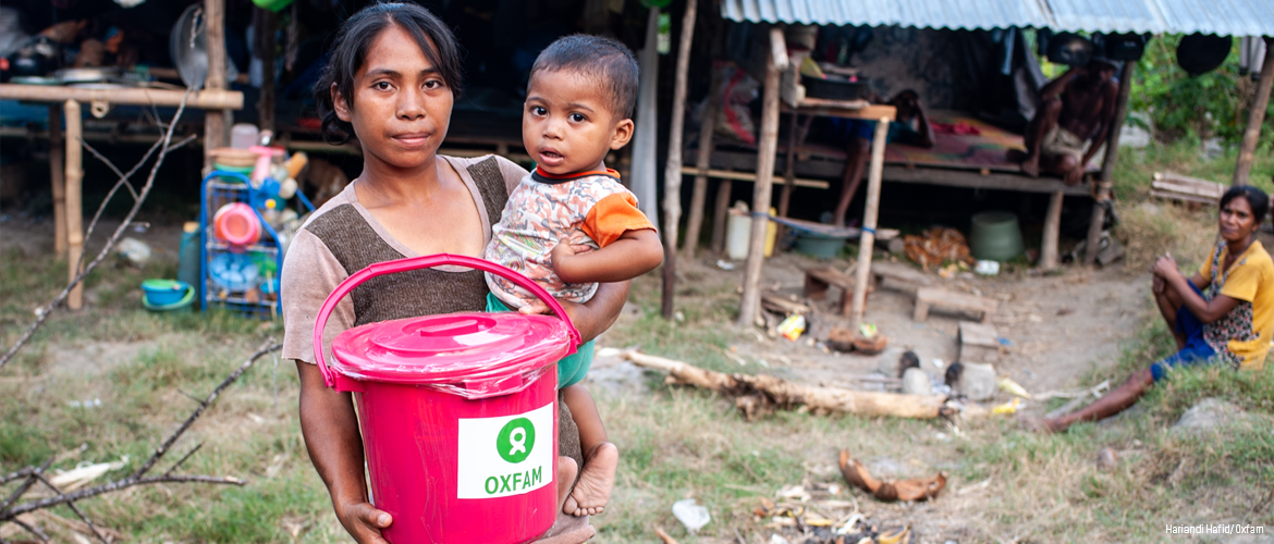 Woman and child with Oxfam hygiene and water aid