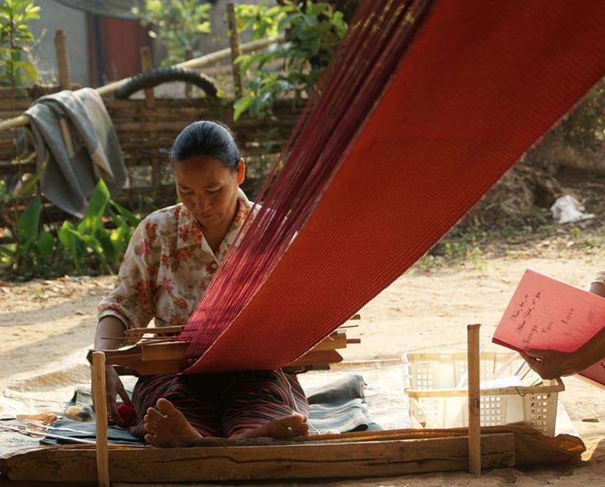 Dee Say using a backstrap loom to weave fabric - Thai Tribal Artisans.