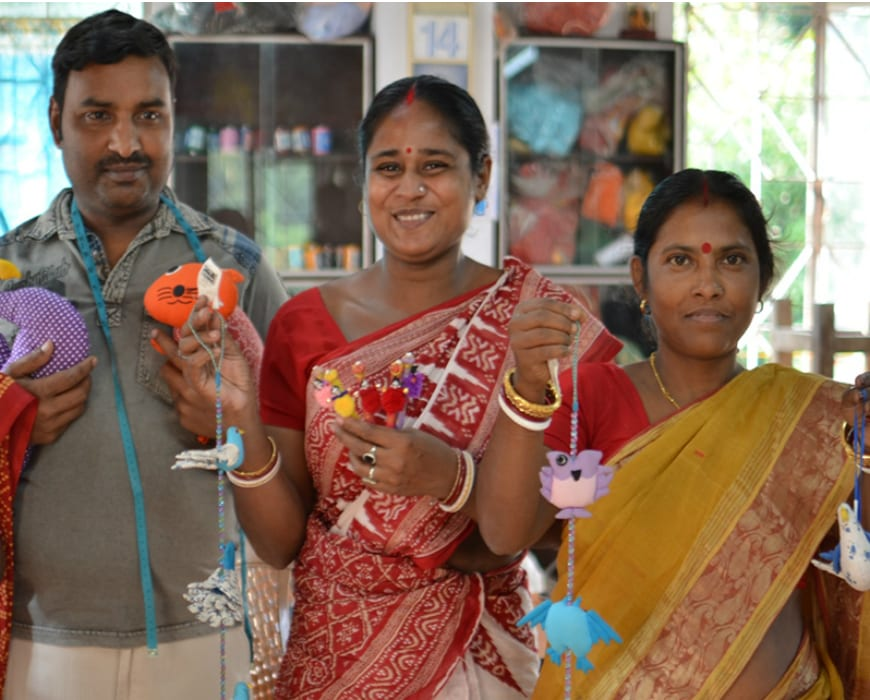 Sasha artisans with their products.