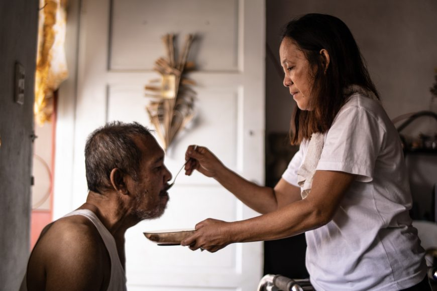 Care worker tending to her husband