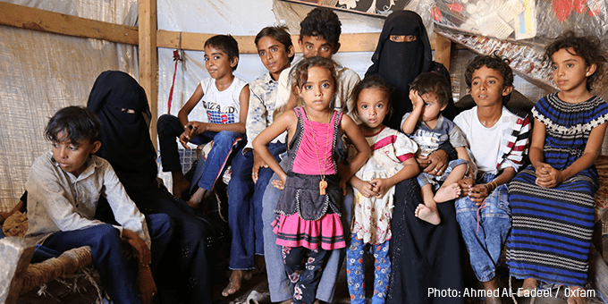 Hind Ahmed with her ten children in their temporary tent, Bani Thawab sub-district
