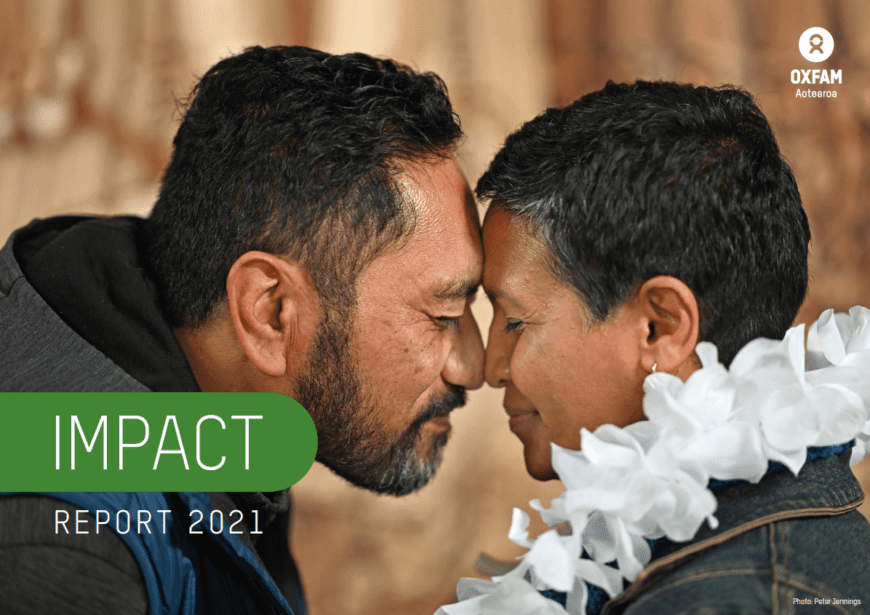 Image of two people engaging in a hongi, with text that reads 'impact report'